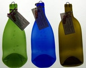 Wine bottles recycled into serving platters, cutting boards and spoon rests