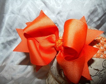 Hairbows..Orange Double Layered Spikey Hair bow with headband..Great for newborn toddler big girl wear