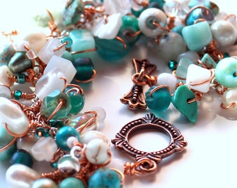 copper wrapped moonstone story bracelet. turquoise and white beads. wire wrapped uniquenecks jewelry. layered gemstones