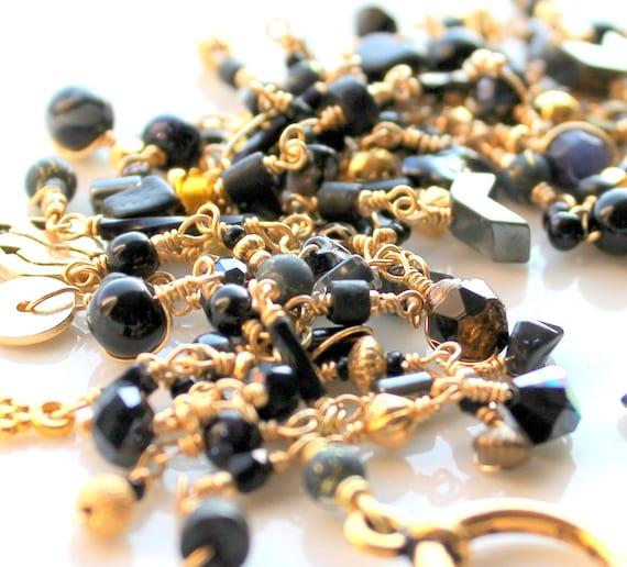 egyptian goddess bracelet. gold plated wire wrapped layered black gold fringe beaded bracelet by uniquenecks