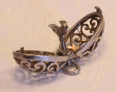 Vintage filigree sterling silver egg or caged bead charm pendant with little bird. Opens