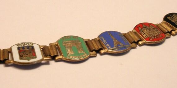 Vintage Paris France souvenir tourist bracelet. Colored enamel panels. French landmarks