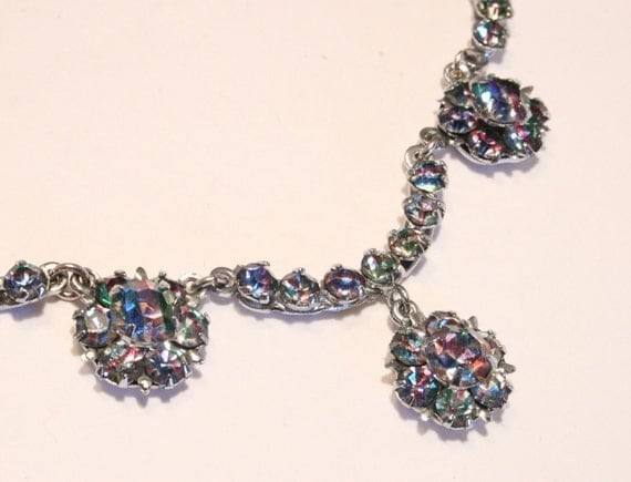 Vintage rainbow crystal rhinestone necklace. Iris glass. Pretty multi colored stones showing pink, blue and green