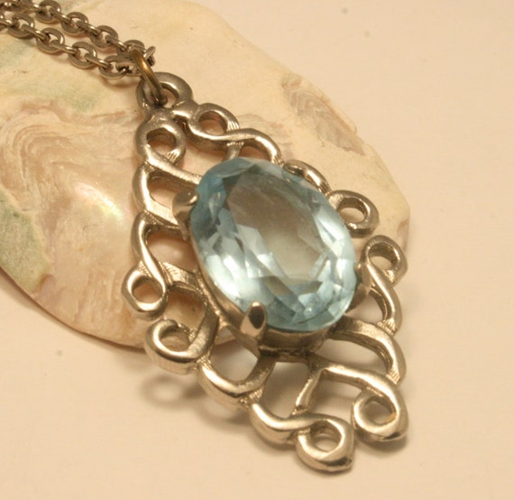 Vintage blue glass pendant. Silverplated Celtic style detail