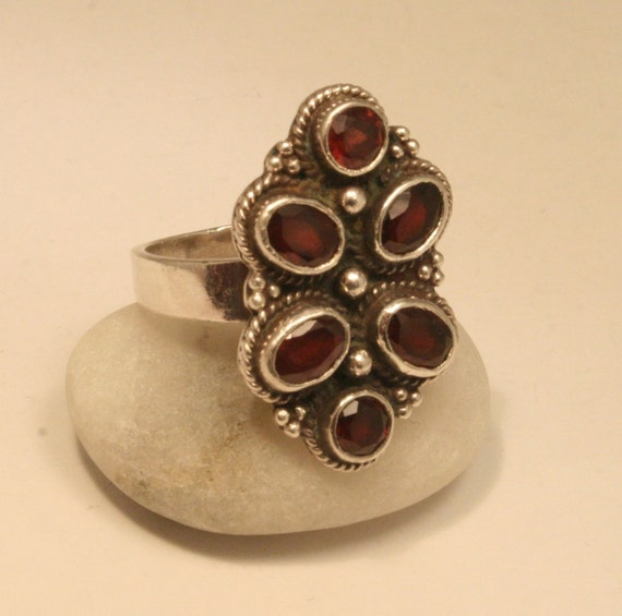 Vintage garnet and sterling silver ring. UK size Q  US size 8.25