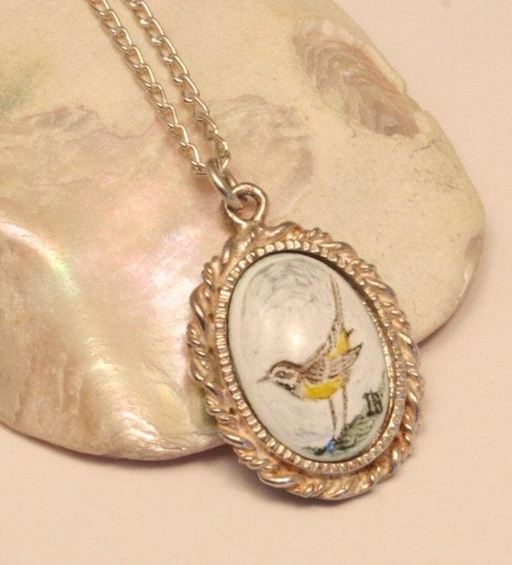 Vintage bird pendant necklace. Sterling silver and enamel