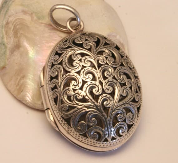 RESERVED for AINDAMAIS.  Vintage sterling silver locket  on sterling silver chain.. Oval. Beautiful fretwork