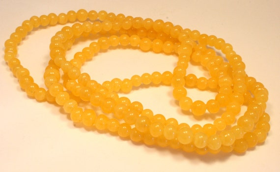 Vintage yellow glass bead necklace. Flapper length. Long