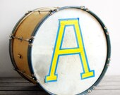 vintage blue and yellow school marching band drum