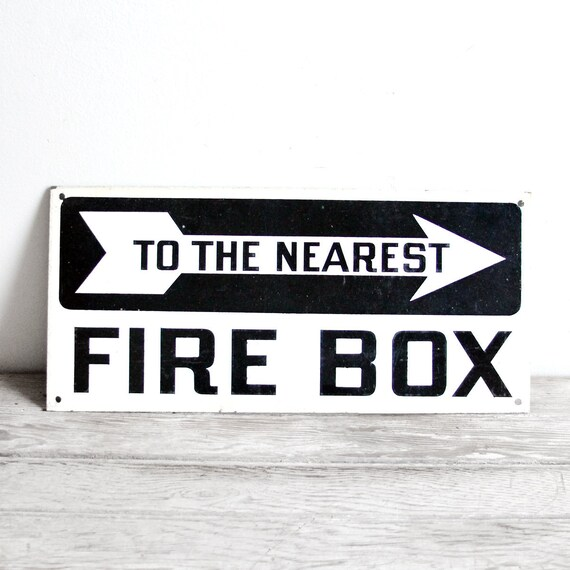"vintage industrial black and white ""to the nearest firebox"" arrow sign"