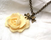 Antiqued Ivory Rose And Bow  Necklace