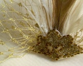 ecru and ivory feathered headpiece with antique beading and gold netting