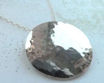 Large silver hammered disc pendant