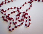 silver (plated) rosary chain with 4mm czech ruby red crystals that are fire polished