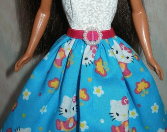 Handmade Barbie clothes - blue and white dress