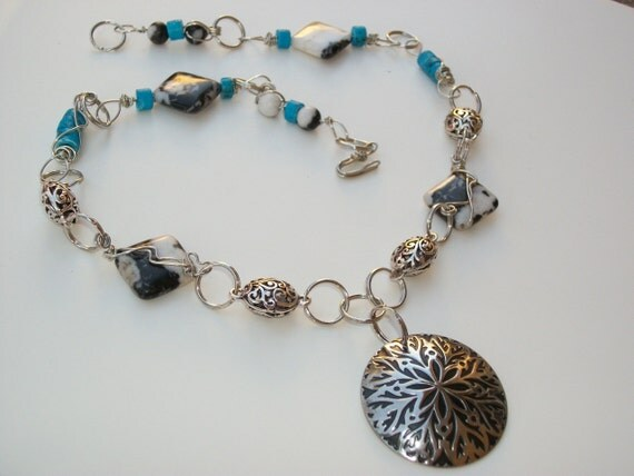 Unique Metal and Beaded Necklace with Blue, Black and White Beads
