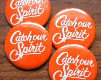 Fun Set of Four Orange Catch Our Spirit Retro Badges