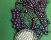 artteam Art Nouveau free form beadwork smokey grey and purple bracelet with 1930's antique patina button