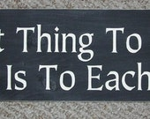 The Best Thing To Hold Onto In Life Is Each Other wooden sign You Pick Colors