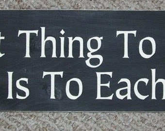 Wooden Inspirational Signs The Best Thing To Hold Onto In Life Is Each Other  6 x 24