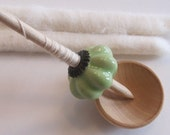 Ceramic bead support spindle with fiber