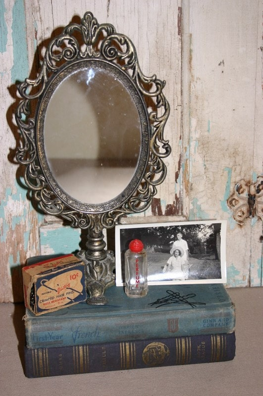 Vintage oval metal dressing table mirror on stand