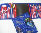Transformers Art Tote complete with chalkboard, chalk, eraser, paper pad, pencil, crayons, and colored pencils