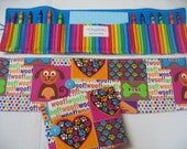 Doggy  Crayon Tote in a colorful print complete with 12 crayons and a paper pad