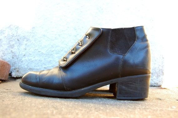 Vintage Black Leather NAOT Chelsea Ankle Boots with Brass Eyelet Buckles and Elastic Ankle