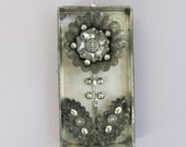 Mixed Media Silver Tin Flower with vintage buttons and vintage tin tart molds