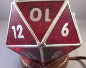 D20 lamp on wooden base