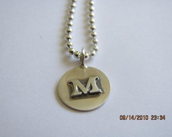 Sterling silver raised initial disc necklace