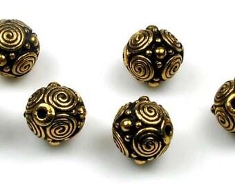 6 gold plated Tierracast spirals beads