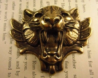 1 Brass Oxide Stamped Snarling Cat
