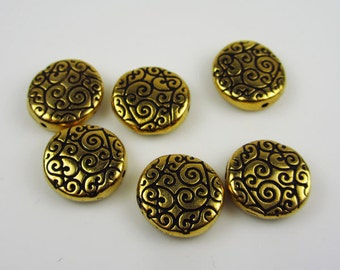 6 Gold Tierracast Flat Round Scroll Beads