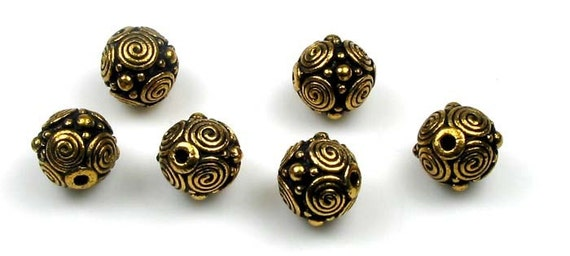 6 gold plated Tierracast spirals beads