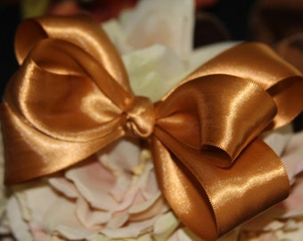 Gold Deluxe Satin Hair Bow. Great for any special occasion.