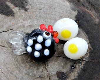 1 Chicken and 1 egg lampwork glass beads- black & white farmyard fun