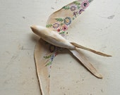 Swallow soft sculpture made from vintage tablecloth.