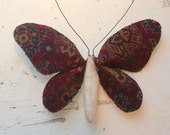 Moth made from vintage upholstery fabric.