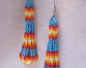 peyote stitch turquoise, red, orange, yellow and white hand beaded earrings