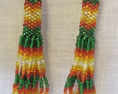 circular peyote stitch green, red, orange, yellow and clear silver lined beads
