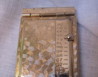 1950's silver tone pop up phonebook  ON SALE