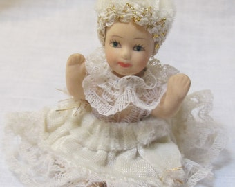 vintage doll with white velvet dress