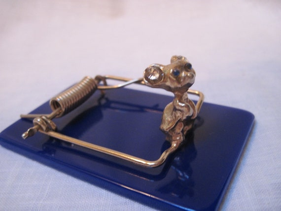 Mouse trap paper weight