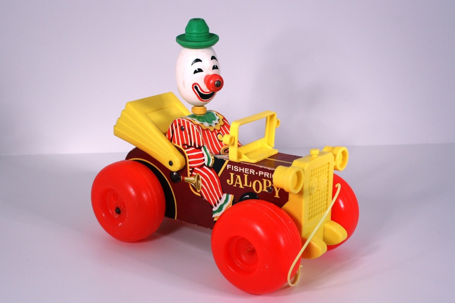 Vintage fisher price 1965 jalopy clown pull toy for Clown fish price