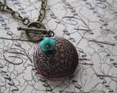 Red copper floral locket