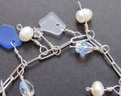 Silver chained sea glass, sea pearl, and antique crystal bracelet clear and blue