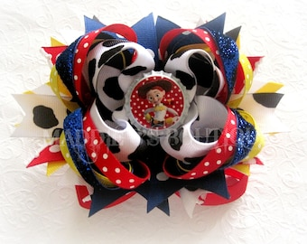 Toy Story Inspired-Jessie Cow Print OTT Stacked hair bow-Disney Toy Story Mania made by Maddie B's Boutique on Etsy