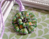 Green flower necklace choker with purple and pink details